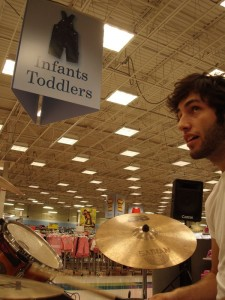 Is Darrin and infant or a toddler? I mean, he IS a drummer...